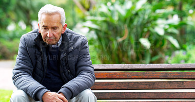 Buy stock photo Cropped shot of a carefree elderly man seated on a bench while contemplating outside in a park