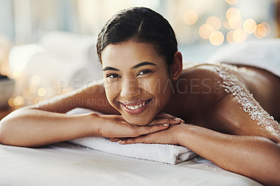 Buy stock photo Portrait of a young woman getting an exfoliating massage at a spa