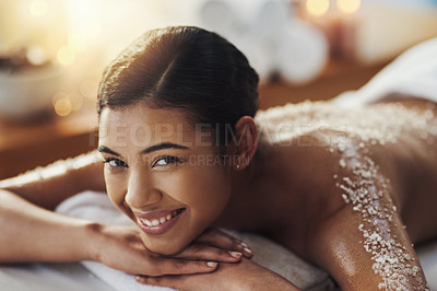 Buy stock photo Shot of a young woman getting an exfoliating massage at a spa