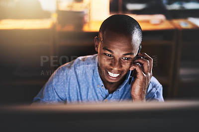Buy stock photo Cropped shot of a handsome young businessman using a mobile phone during a late night in a modern office