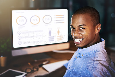 Buy stock photo Cropped portrait of a handsome young businessman using a computer to look at graphs during a late night in a modern office