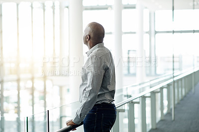 Buy stock photo Shot of a mature businessman looking thoughtful in an office
