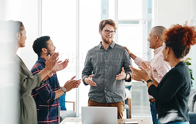 Buy stock photo Shot of a group of young businesspeople clapping during a meeting in a modern office