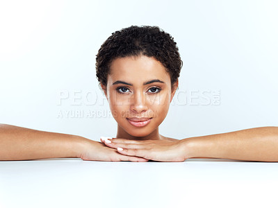 Buy stock photo Portrait of an attractive young woman posing against a white background