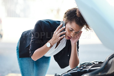Buy stock photo Cropped shot of an attractive young  woman calling roadside assistance after breaking down