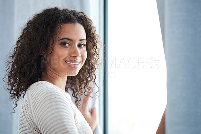 Buy stock photo Cropped shot of a beautiful young woman spending the day at home