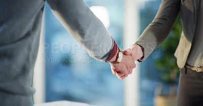 Buy stock photo Cropped shot of two unrecognizable businesspeople shaking hands in agreement in the office at work