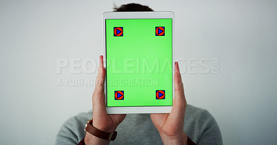 Buy stock photo Studio shot of an unrecognizable man holding a digital tablet in front of his face while standing against a grey background