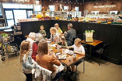 Buy stock photo Shot of a family having lunch at a cafe in a supermarket