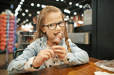 Buy stock photo Cropped shot of an adorable little girl enjoying dessert in a cafe