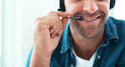 Buy stock photo Shot of an unrecognizable call centre agent working in his office