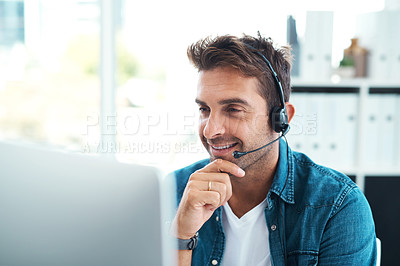 Buy stock photo Shot of an attractive young call centre agent working in his office