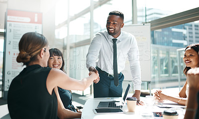 Buy stock photo Shot of colleagues shaking hands in a meeting