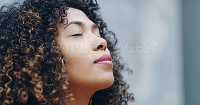 Buy stock photo Shot of a confident young woman looking thoughtful while standing outdoors