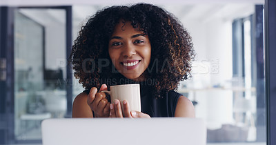 Buy stock photo Portrait of a young businesswoman drinking coffee while working on a laptop in an office