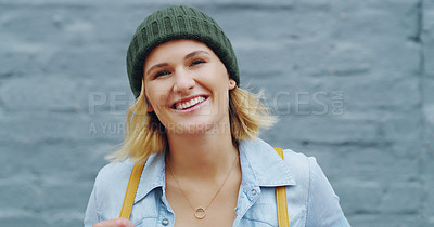 Buy stock photo Portrait of a confident young woman standing against a grey wall outdoors
