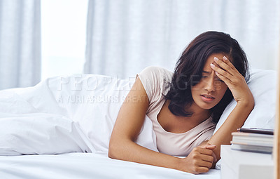Buy stock photo Shot of a young woman feeling unwell in the morning at home