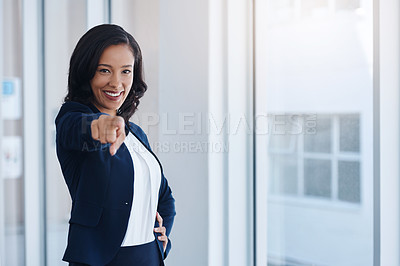 Buy stock photo Portrait of a young businesswoman pointing towards the camera in an office