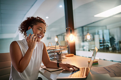 Buy stock photo Shot of a happy young businesswoman speaking on the phone during a late night at work