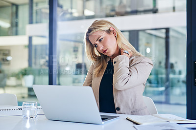 Buy stock photo Cropped shot of an attractive young businesswoman suffering with neck pain while working in her corporate office