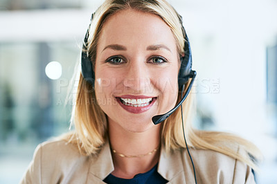 Buy stock photo Cropped portrait of an attractive young female call center agent working on a laptop in her office