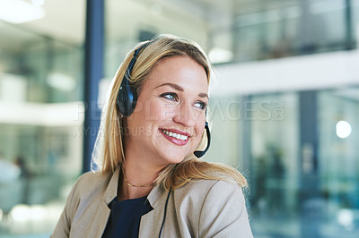 Buy stock photo Cropped shot of an attractive young female call center agent working on a laptop in her office