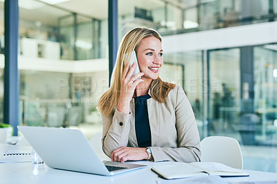 Buy stock photo Cropped shot of an attractive young businesswoman making a phonecall while working in her corporate office