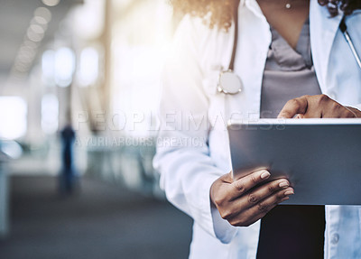Buy stock photo Cropped shot of an unrecognizable doctor using a digital tablet