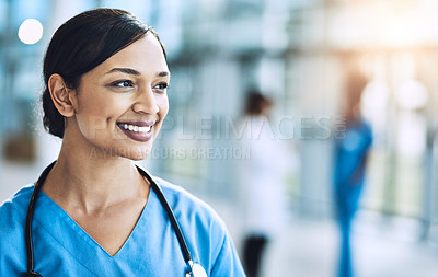 Buy stock photo Cropped shot of a female nurse standing in a hospital