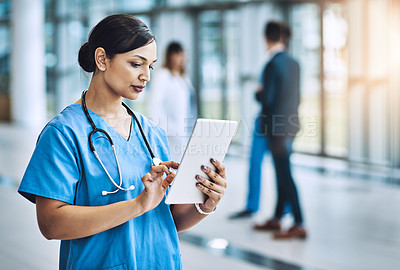 Buy stock photo Cropped shot of a female nurse using a digital tablet