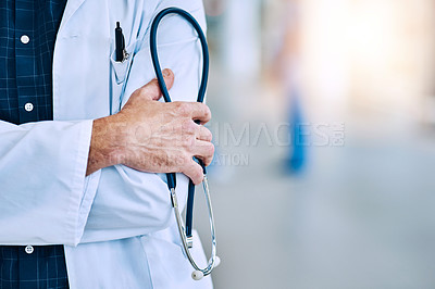 Buy stock photo Cropped shot of an unrecognizable doctor holding a stethoscope