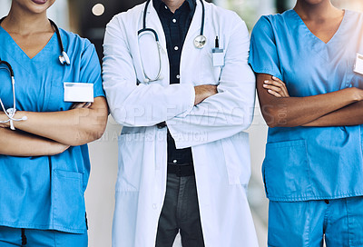 Buy stock photo Cropped shot of three medical practitioners standing together