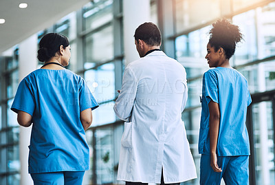 Buy stock photo Shot of medical practitioners having a conversation in a hospital