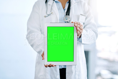 Buy stock photo Closeup shot of an unrecognizable doctor holding a digital tablet with a chroma key screen