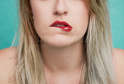 Buy stock photo Studio shot of an unrecognizable young woman posing against a colored background