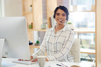 Buy stock photo Cropped portrait of an attractive young female customer service representative at work in an office