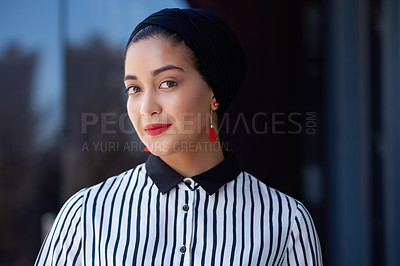 Buy stock photo Shot of a confident young businesswoman standing on the balcony of a modern office