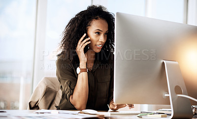 Buy stock photo Shot of a businesswoman talking on her cellphone while working on her computer
