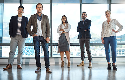 Buy stock photo Portrait of a diverse group of businesspeople standing in an office