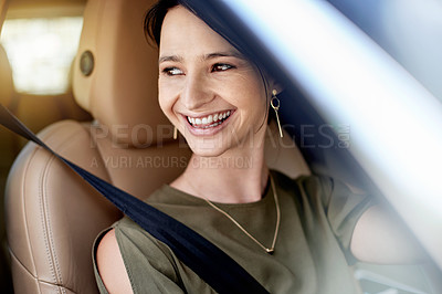 Buy stock photo Shot of a beautiful young woman driving her car to work during the day