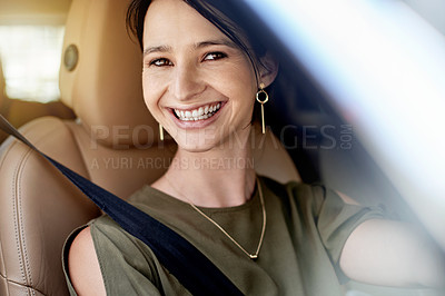 Buy stock photo Portrait of a beautiful young woman driving her car to work during the day
