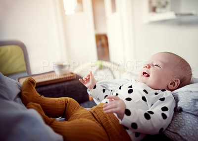 Buy stock photo Cropped shot of an adorable baby bonding with her mother at home