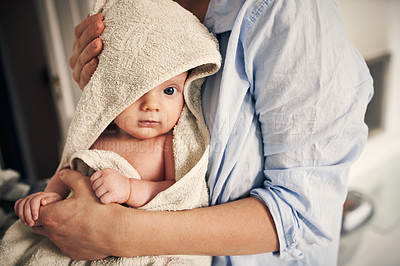Buy stock photo Cropped shot of a baby being dried with a towel by her unrecognizable mother at home