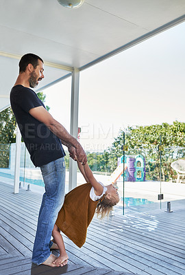 Buy stock photo Full length shot of an affectionate man being playful with his daughter on their veranda at home
