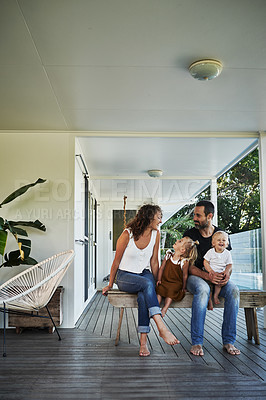 Buy stock photo Full length shot of a happy family spending time together on their veranda at home