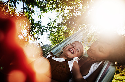 Buy stock photo Cropped shot of an affectionate woman spending time with her daughter at the park