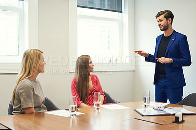 Buy stock photo Shot of a group of young businesspeople having a meeting together in an office