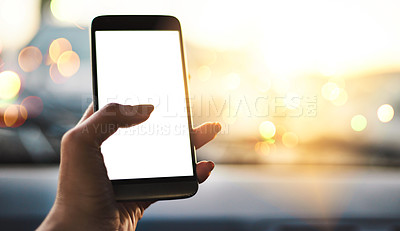 Buy stock photo Cropped shot of an unrecognizable woman using her smartphone