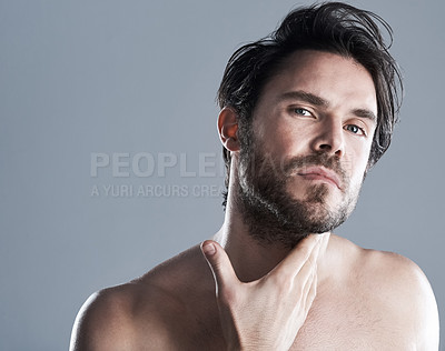Buy stock photo Studio shot of a muscular young man posing against a grey background