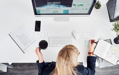 Buy stock photo High angle shot of a young businesswoman working on a computer in a modern office